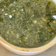 Closeup of bowl of freshly made chimichurri sauce from Argentina